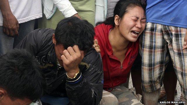 Relatives grieve bodies found in New Bataan.
