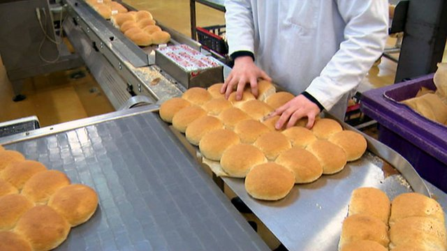 Bread rolls coming off the production line in a factory