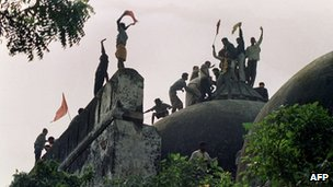 file photograph taken on December 6, 1992, Hindu youths clamour atop the 16th century Muslim Babri Mosque