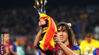 Carlos Puyol with the Club World Cup trophy