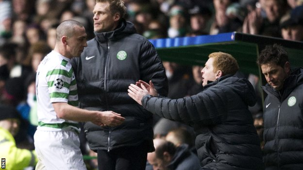 Brown is congratulated for his performance by manager Neil Lennon
