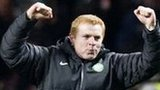 Neil Lennon (left) celebrates Celtic's win over Spartak Moscow