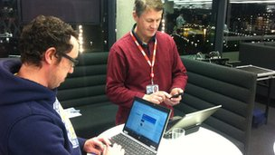 BBC staff using laptops in BBC building