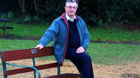 Dennis Bannister sitting on the memorial bench