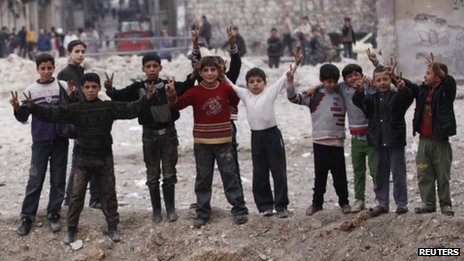 Syrian children flash victory signs
