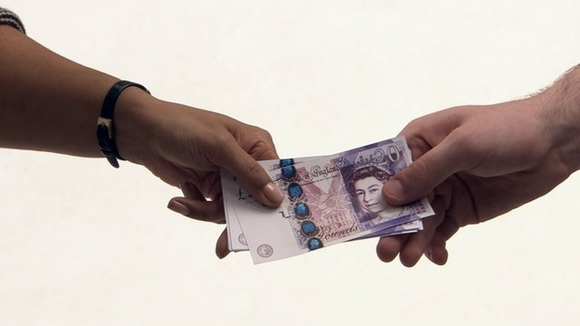 Handing over £20 notes