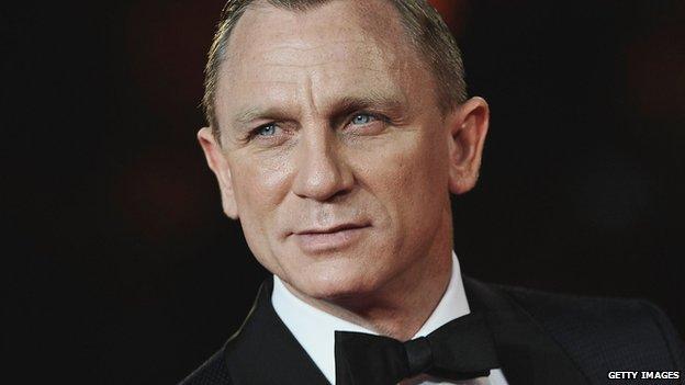Daniel Craig in a smart suit.