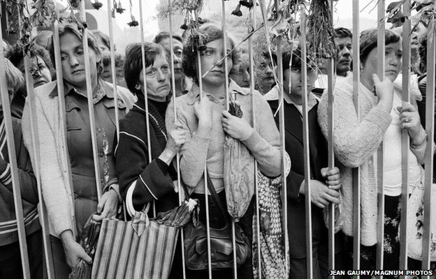 Relatives of the strikers wait outside the headquarters of the Gdansk shipyards