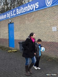 A young player of the soccer club Buitenboys arrives at the clubhouse in Almere December 4, 2012.