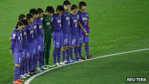 Players of the Japanese team Sanfrecce Hiroshima observe a minute&#039;s silence at football&#039;s Club World Cup on Thursday