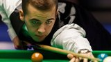 Luca Brecel plays a shot against Shaun Murphy