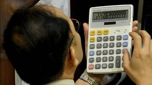 Man using a calculator