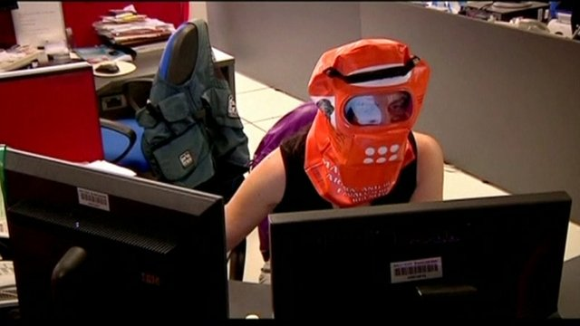An office worker in Buenos Aires wearing a protective facemask