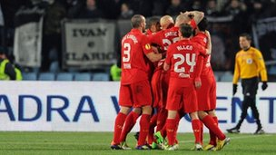 Liverpool celebrate scoring against Udinese