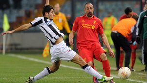Marco Faraoni of Udinese (left) competes with Jose Enrique of Liverpool