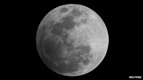 A penumbral eclipse of the moon is seen in the night sky in Manila 28 November 2012