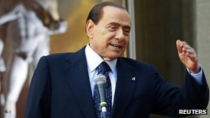 Then Italian Prime Minister Silvio Berlusconi speaks during the &quot;Campus Mentis&quot; award ceremony in Rome April 8, 2011