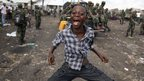 A boy dances to celebrate the return of government soldiers to Goma
