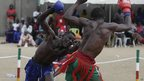 Issah Abu from Nigeria's Kogi state, left, fights with Ali Pillow from Kano state in the traditional Nigerian boxing Dambe contest in Lagos (1 December 2012)