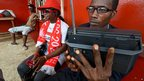 Ruling party supporters listening to the radio in Freetown, Sierra Leone - Monday 26 November 2012