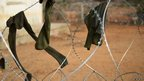 Drying socks on barbed wire at Kismayo airport, Somalia - Wednesday 28 November 2012