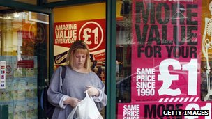 A shopper exits a pound shops