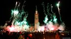 Spectators watch fireworks during a Christmas light illumination ceremony on Parliament Hill in Ottawa
