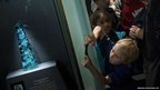 People view the Dom Pedro after its unveiling in the Janet Annenberg Hooker Hall of Geology, Gems and Minerals at the Smithsonian's National Museum of Natural History in Washington DC