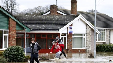 Residents of St Asaph, Denbighshire pictured in recent flooding