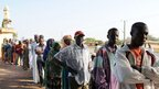 Voters queue near a mosque before casting their ballots at a polling station in Bole, northern Ghana. Photo: 7 December 2012