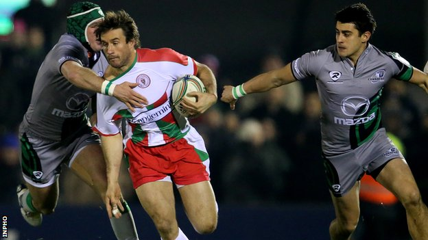 Connacht's Dave McSharry and Tiernan O'Halloran tackle Marcelo Bosch of Biarritz