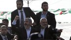 Khaled Meshaal (L), with senior Hamas leader Ismail Haniyeh (R) upon his arrival in the southern Gaza Strip December 7, 2012.