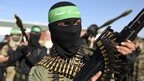 Members of the al-Qassam brigades stand guard as they wait for the arrival of Hamas chief Khaled Meshaal in Rafah December 7, 2012