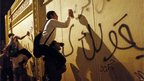 Egyptian protesters spray graffiti on the outer walls of the presidential palace during a demonstration against President Mohammed Morsi in Cairo, 7 December 2012. 