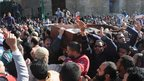 Members of the Muslim Brotherhood and supporters of President Morsi at funeral march for two members of the Muslim Brotherhood Youth.