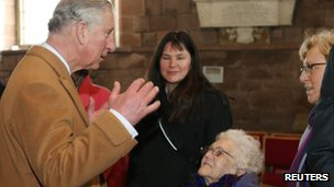 Prince Charles speaking to flooding victims in St Asaph