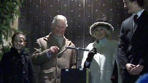 Prince Charles and his wife Camilla turn on the lights