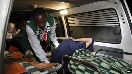 An unidentified victim is brought to a hospital after an explosion in Nairobi, Kenya
