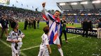 David Beckham salutes the fans as he walks off the pitch in Carson, California