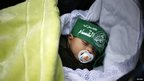 A Palestinian baby wearing a Hamas headband at the rally in Gaza, 8 Dec