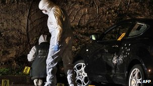 Forensics team examines a bullet-ridden car in Calvi. Photo: 7 December 2012