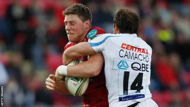 Rhys Priestland is halted by Gonzalo Camacho,