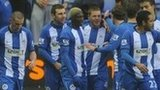 Wigan celebrate James McCarthy's goal against QPR