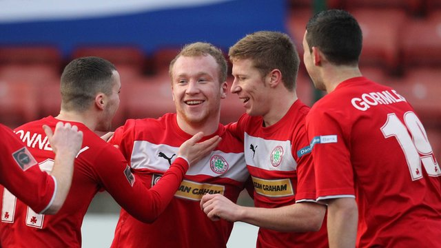 Cliftonville players celebrate with Liam Boyce