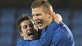 Andy McGrory congratulates goalscorer Andy Mitchell