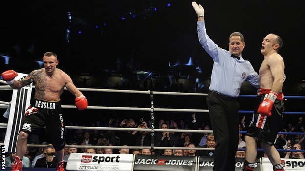 Mikkel Kessler starts celebrating after the fight against Brian Magee is stopped