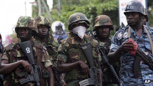 Soldiers stand guard after protests over alleged improper vote counting in Accra, Ghana, on 8/12/12