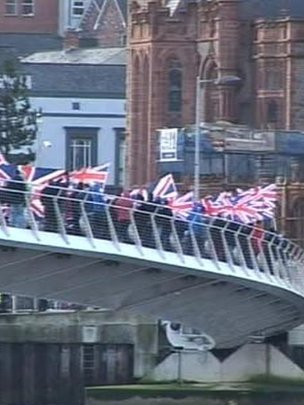 Loyalists march over Londonderry peace bridge