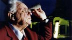 Sir Patrick Moore looks at the night&#039;s sky through a toilet roll