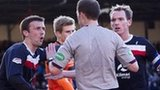 Dundee players surround Collum